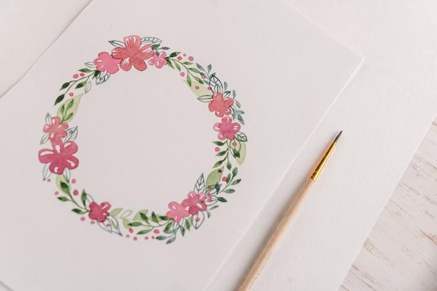 Design della cornice di fiori dipinti con acquerelli su carta Foto Gratuite