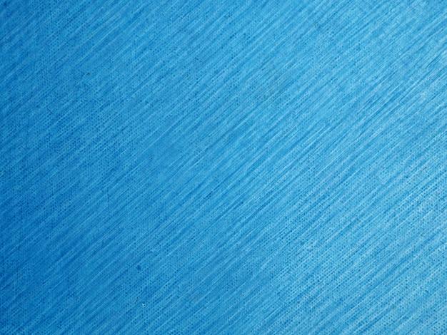 Dipinga il fondo astratto blu scuro decorativo di colore di pendenza della parete di lerciume astratto con la matita della linea blu sul fondo e sulla struttura dell'estratto della tela. Foto Premium