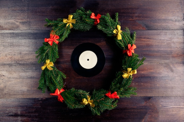 Disco grammofonico in vinile in stile natalizio Foto Premium
