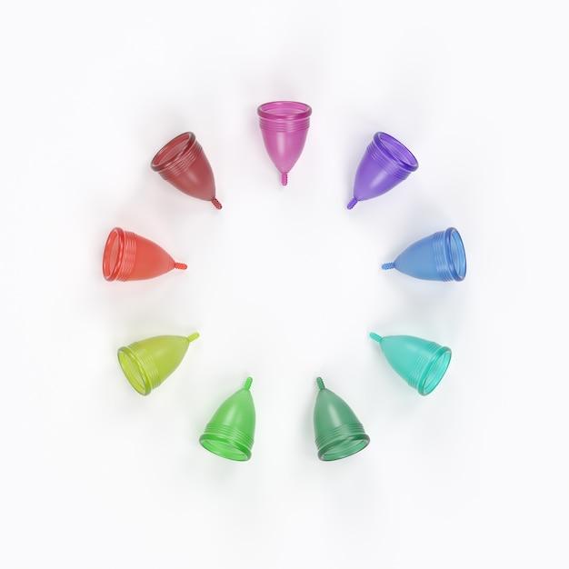 Diverse coppette mestruali di vari colori. Foto Premium
