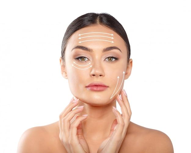 Donna con linee tratteggiate sul viso Foto Premium