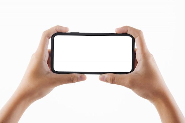 Donna della mano del primo piano che giudica isolato lo schermo in bianco nero dello smartphone Foto Premium