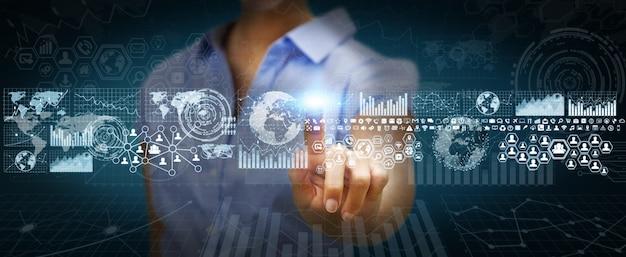 Donna di affari che per mezzo dello schermo tattile digitale con i grafici Foto Premium