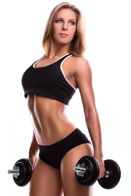 Donna forte fitness con manubri Foto Premium