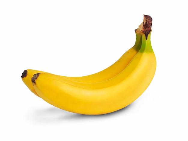 Due banane fresche isolate su uno sfondo bianco Foto Premium