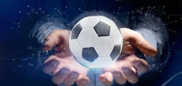 Equipaggi la tenuta della sfera di calcio e della rappresentazione isolata collegamento 3d Foto Premium