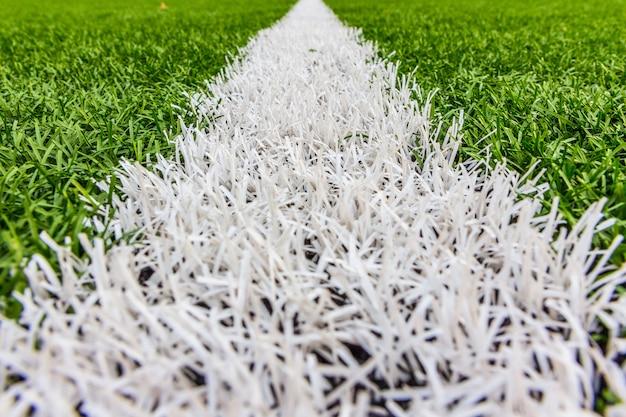 Erba artificiale con strisce bianche, stadio di calcio Foto Premium