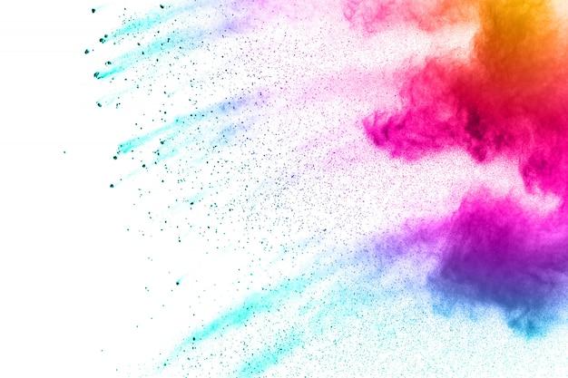 Esplosione di polvere colorata. spruzzi di particelle di polvere color pastello. Foto Premium