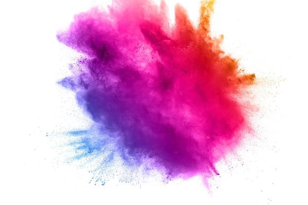 Esplosione di polvere di multi colore astratto su sfondo bianco. Foto Premium