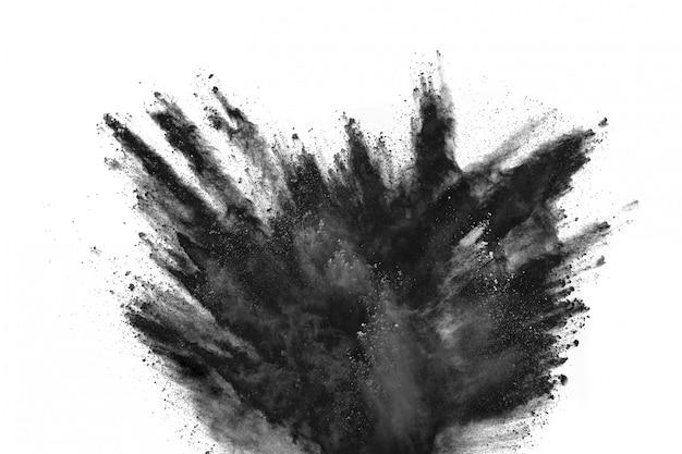 Esplosione di polvere nera su sfondo bianco. Foto Premium