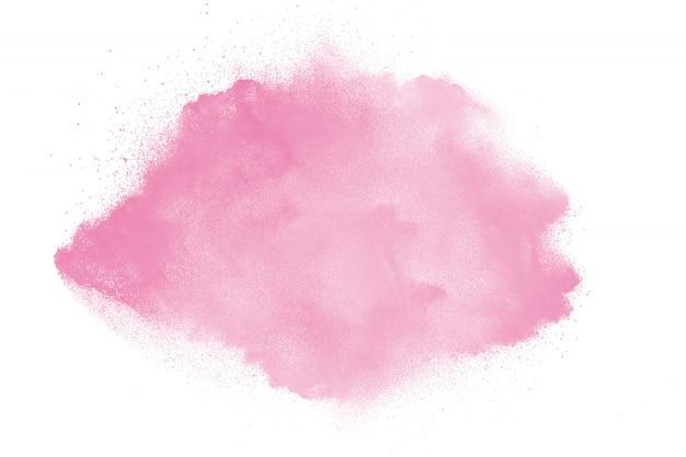 Esplosione di polvere rosa su sfondo bianco Foto Premium