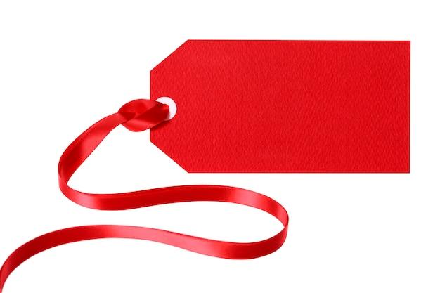Etichetta regalo rosso o biglietto di prezzo con nastro rosso riccio Foto Gratuite