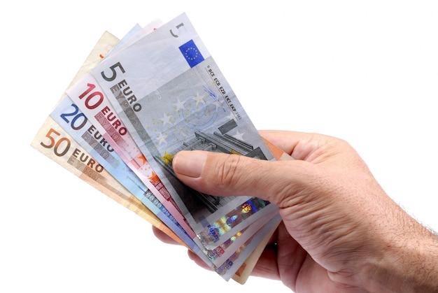 Euro tenuti in mano Foto Gratuite