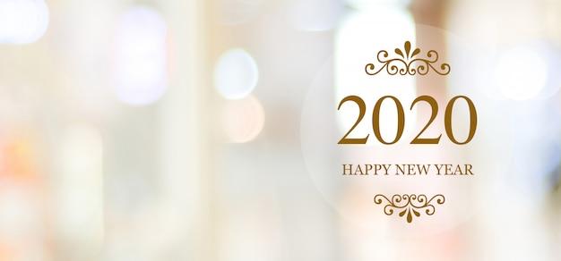 Felice nuovo anno 2020 su sfocatura sfondo astratto bokeh Foto Premium