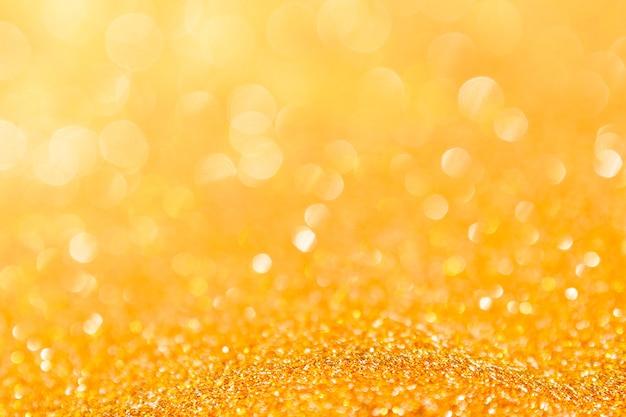 Festa di natale del bokeh della luce dell'oro astratto del fondo Foto Premium