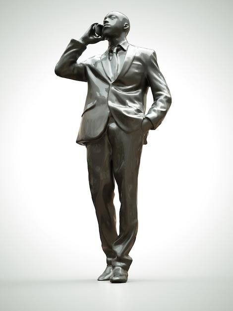 Figura di plastica di un uomo di colore in un vestito che parla al telefono Foto Premium