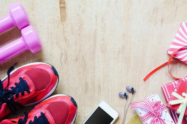 Fitness, stili di vita sani e attivi presentano il concetto di scatole Foto Premium