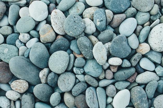 Fondo astratto con le pietre peeble rotonde asciutte. Foto Premium
