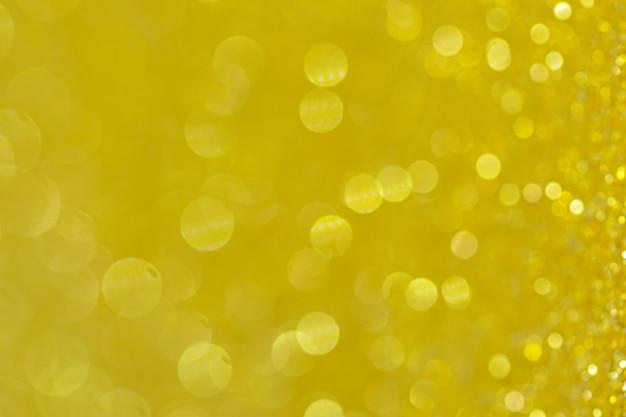 Fondo astratto di giallo del cerchio di bokeh Foto Premium