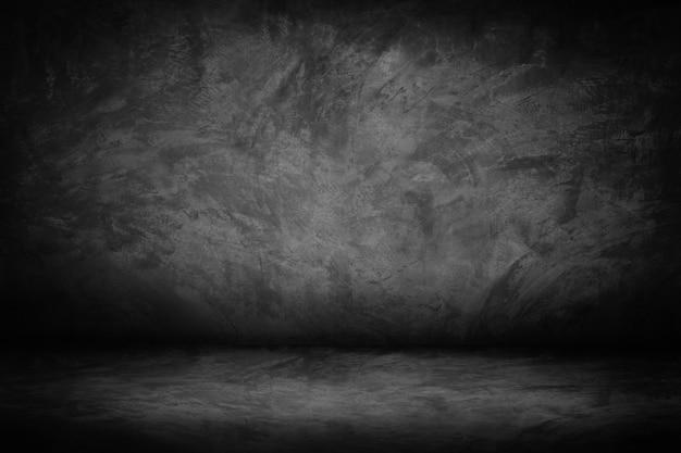 Fondo astratto di pendenza della parete del nero e dello studio della parete del cemento nero e scuro e grigio Foto Premium