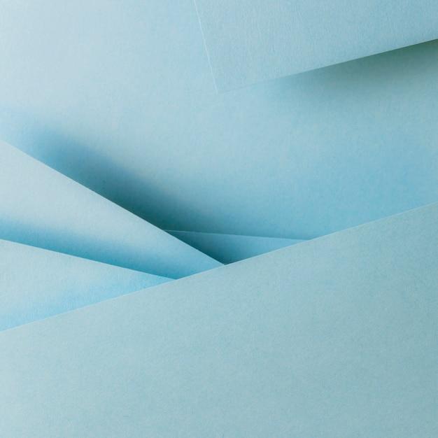 Fondo blu dell'insegna della composizione nella geometria delle carte di colore Foto Gratuite