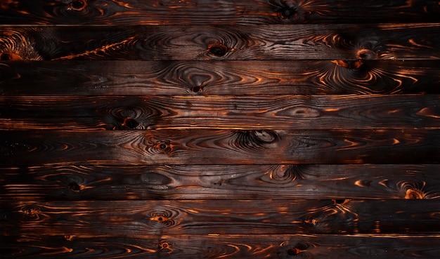 Fondo bruciato di struttura del bordo di legno Foto Premium