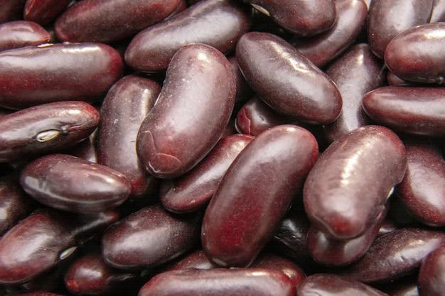 Fondo dei fagioli del fagiolo rosso (fagiolo rosso) / concetto del vegano / dieta della proteina Foto Premium