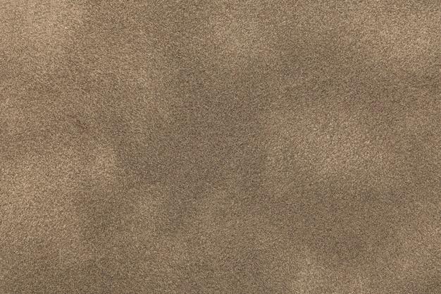 Fondo del primo piano leggero del tessuto della pelle scamosciata del bronzo. Foto Premium