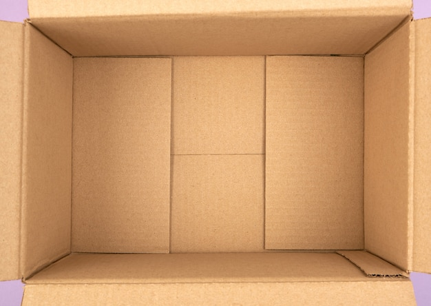 Fondo della scatola di cartone marrone vuota aperta Foto Premium