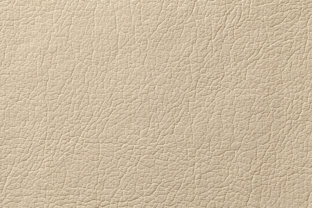 Fondo di cuoio beige leggero di struttura con il modello, primo piano Foto Premium