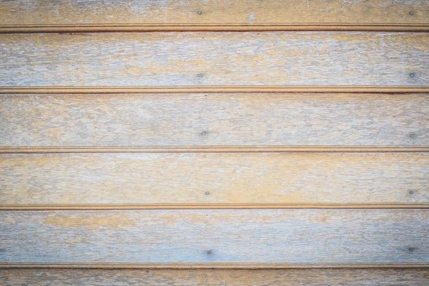 Fondo di legno di struttura della parete del vecchio bordo marrone del compensato Foto Premium
