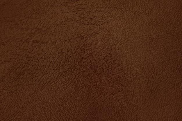 Fondo di struttura del cuoio di marrone scuro con superficie senza cuciture e alta risoluzione. Foto Premium
