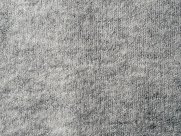 Fondo di struttura del tessuto del maglione grigio Foto Premium