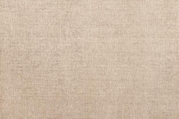 Fondo di struttura del tessuto di cotone marrone, modello senza cuciture del tessuto naturale. Foto Premium