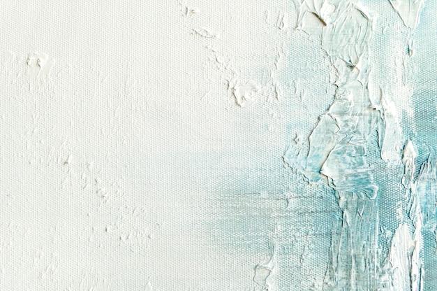 Fondo di struttura della tela con pittura blu variopinta astratta di arte. Foto Premium