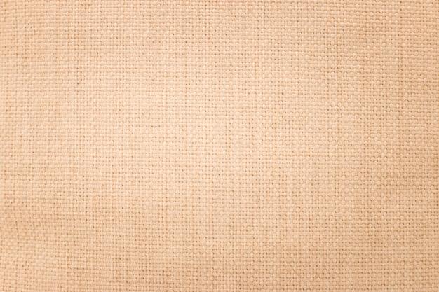 Fondo di struttura della tela da imballaggio di brown. materiale tessile o tessuto bianco. Foto Premium