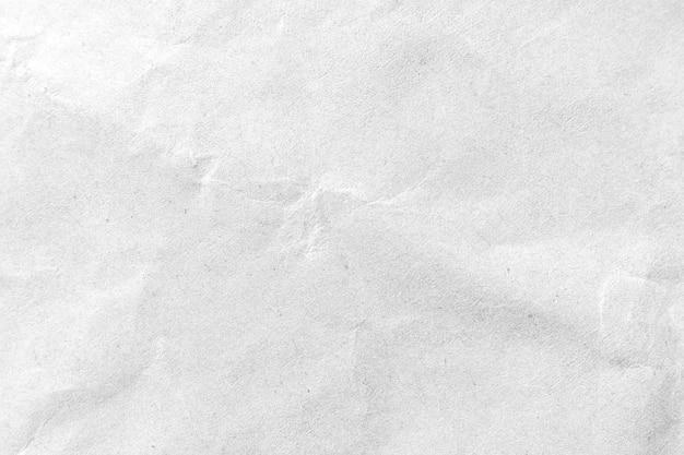 Fondo di struttura di carta sgualcito bianco. avvicinamento. Foto Premium