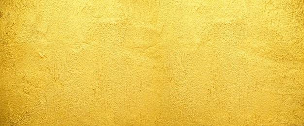 Fondo dorato di struttura della parete per la superficie ruvida del vecchio muro di mattoni dorato. Foto Premium