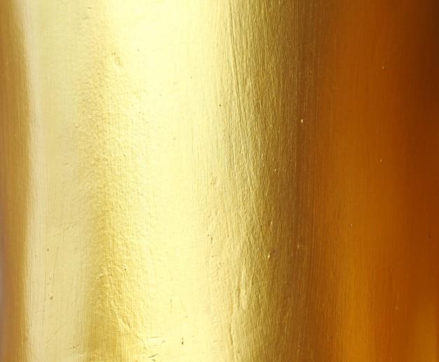 Fondo e struttura dell'estratto della parete dell'oro. Foto Premium
