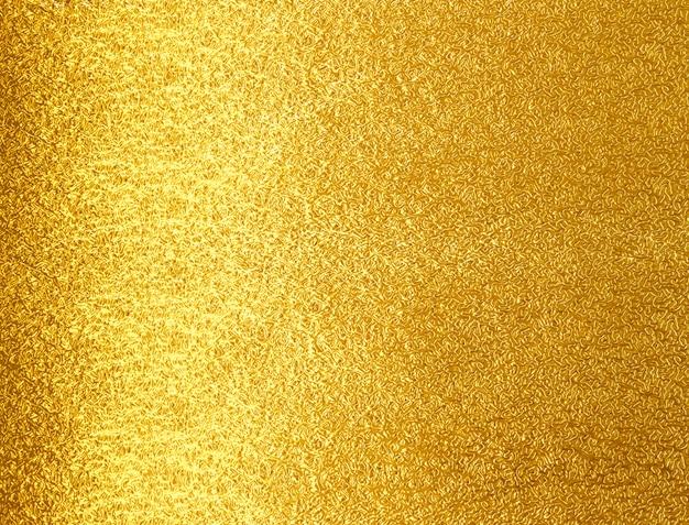 Fondo giallo brillante di struttura del metall dell'oro della foglia Foto Premium