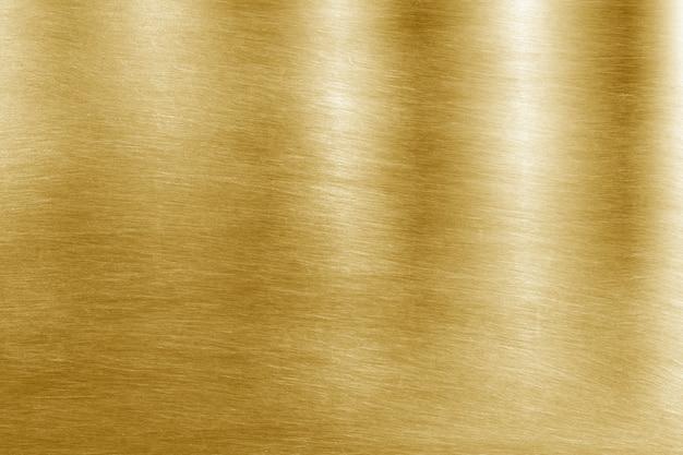Fondo giallo brillante di struttura della stagnola di oro della foglia Foto Premium