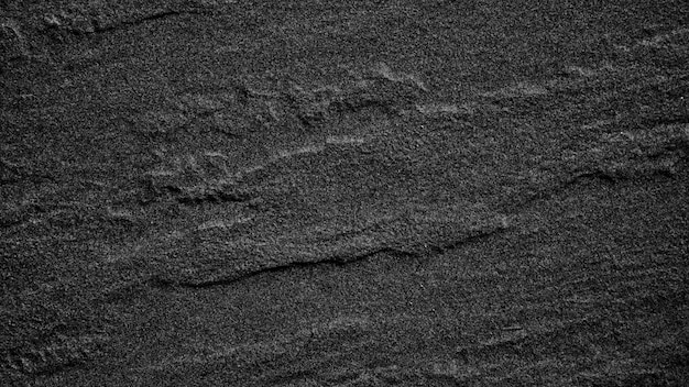 Fondo o struttura di pietra nero grigio scuro dell'ardesia. Foto Premium