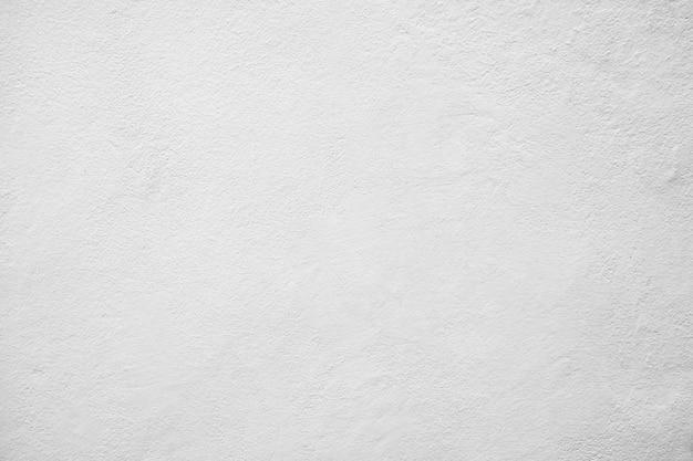 Fondo sporco bianco della parete del cemento. Foto Premium