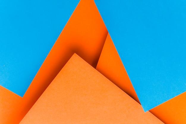 Forme realizzate con carta blu e carta arancione Foto Gratuite