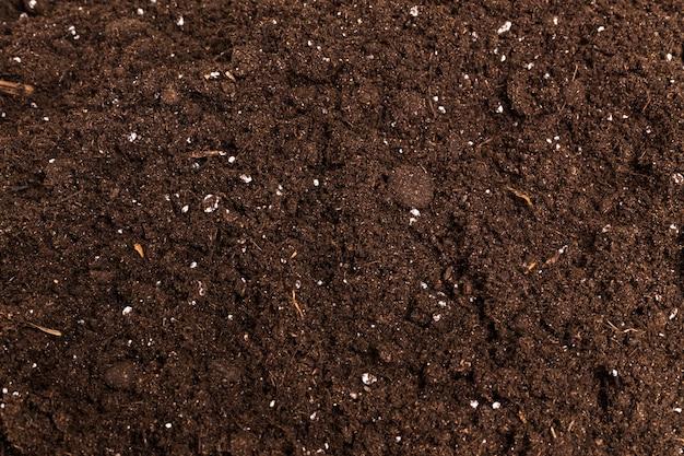 Foto estrema del primo piano di struttura della polvere del caffè di brown Foto Premium