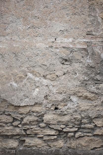 Frammento di vecchia struttura grungy con vernice scheggiata e crepe o superficie grigia del cemento e del muro di cemento Foto Gratuite