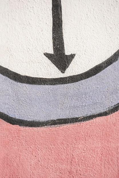 Freccia a punta e graffiti sul muro Foto Gratuite
