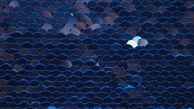 Full frame di paillettes blu con texture di sfondo Foto Gratuite