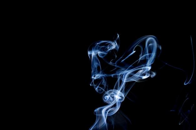 Fumo astratto di fondo nero di joss stickon Foto Premium