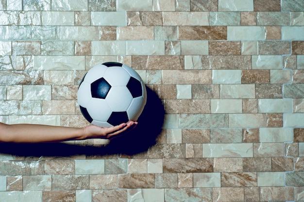 Giocatore di football per esercitare il concetto di calcio e c'è uno spazio di copia. Foto Premium